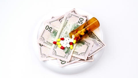 Dollars and pills turning Stock Video Footage