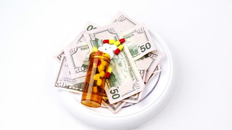 Dollars And Pills Turning stock footage