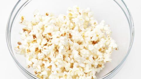 Popcorn falling in a bowl Footage