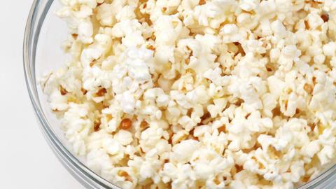 Bowl full of popcorn turning Footage
