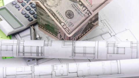 Dollar house, blueprints and calculator turning Footage