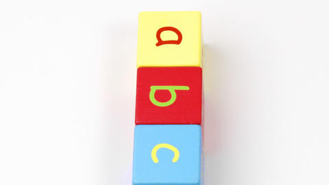 Colorful alphabet toy blocks spelling ABC turning Footage