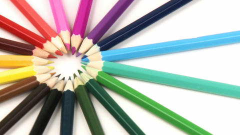 Close up of colour pencils in a circle turning aga Footage