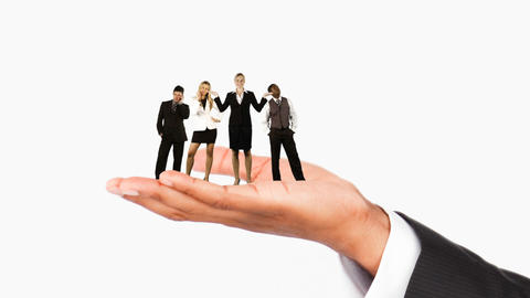Human hand holding business people. Concept of giving work Animation