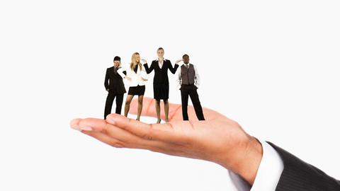 Human hand holding business people. Concept of giving work, Stock Animation
