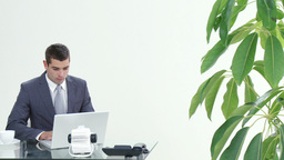Panorama of businessman working in office Footage