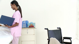 Panorama of AfroAmerican nurse talking to a little Stock Video Footage