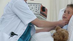 Female doctor examining child throat Footage