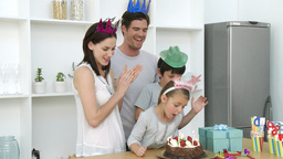 Little girl blowing out candles on her birthday Footage