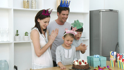 Little girl blowing out candles on her birthday Stock Video Footage