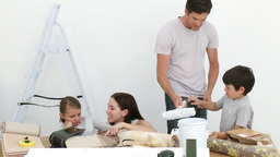Happy family painting a room Stock Video Footage