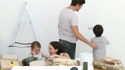 Happy family painting a room Footage