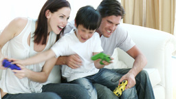 Family playing video Games at home Stock Video Footage