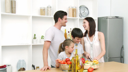 Family at home in Kitchen Preparing Lunch Footage