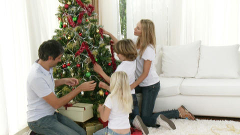 Panorama of family decorating the Christmas tree Footage