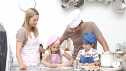 Children baking cookies with their parents Footage