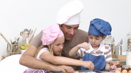 Father and children baking Footage