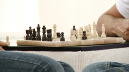 Close up of two people playing chess Footage