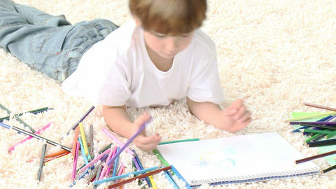 Child painting in livingroom on floor Stock Video Footage