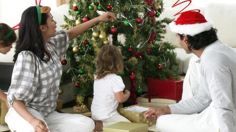 Panorama of family decorating Christmas tree Footage