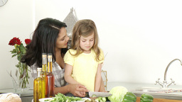 Mother and daughter preparing a salad Stock Video Footage