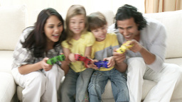 Family playing video games on the sofa Footage