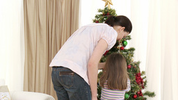 Mother and daughter decorating Christmas tree Footage