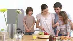 Family preparing a healthy breakfast in the kitche Stock Video Footage