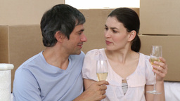 Couple drinking champagne in new house Footage