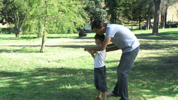 Father teaching his son how to play baseball Stock Video Footage