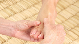 Young Womans feet being massaged Stock Video Footage