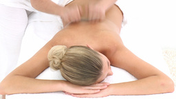 Young woman lying on massage table at spa Stock Video Footage