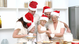 Family doing their Christmas baking at home Footage