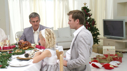 Family Sitting Down to Christmas Dinner Stock Video Footage