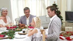 Family Sitting Down to Christmas Dinner Live Action