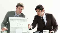 Businessmen working together in an office Footage