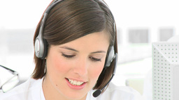 Businesswoman talking on a headset in the office Footage