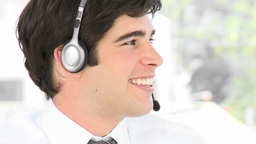 Young attractive businessman talking on a headset Footage