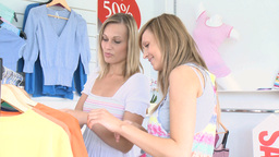 Two cheerful women are doing shopping Stock Video Footage