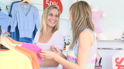Two cheerful women are doing shopping Footage