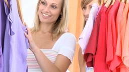 Radiant women choosing Tshirts Footage