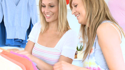 Young cute women trying pullover Stock Video Footage