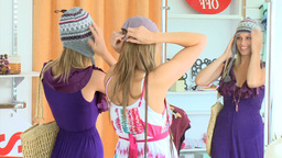Positive women wearing hat looking at the mirror Stock Video Footage