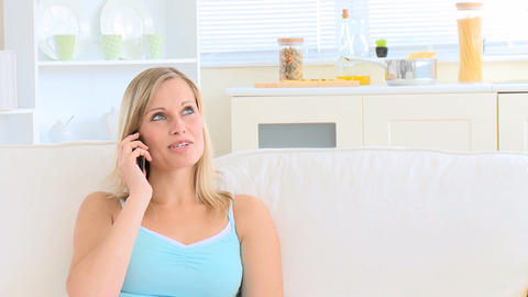 Bright young woman talking on phone Stock Video Footage