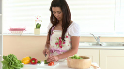 Concentrated asian woman preparing a salad Stock Video Footage