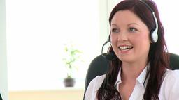 Pretty businesswoman using headset Footage