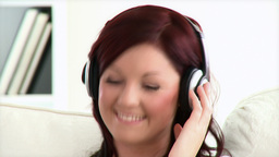 Delighted young woman listen to music wearing head Footage