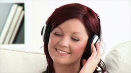 Delighted young woman listen to music wearing head Stock Video Footage