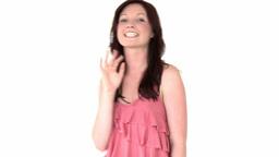 Cheerful young woman looking at camera Footage