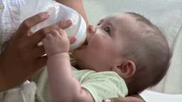Young mother feeding her baby Stock Video Footage